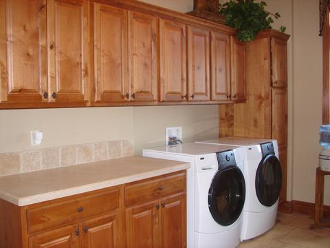 Laundry With Lots Of Folding Space And A Built In Broom Cabinet.