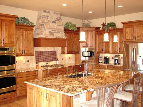 Large Kitchen With Alder Cabinets Designed Stagggered Uppers And A 4 Piece Crown Molding